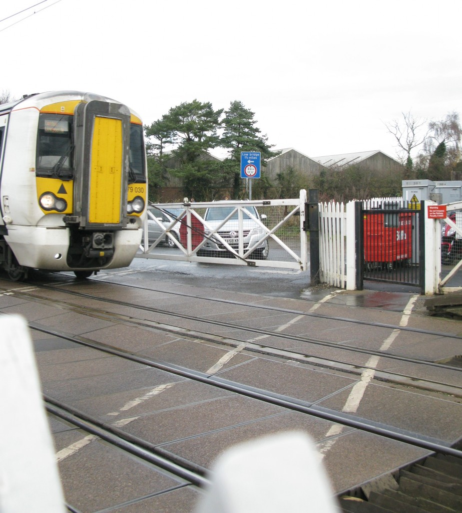 Greater Anglia 379 030 passes over the station's road and footpath crossings (Photo: © London Intelligence)