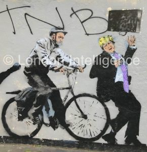 Graffiti art and graffiti near Regent Street in central London: The cycle of fortunes for London politicians. Jeremy Corbyn (Labour and left)and Boris Johnson (Conservative and right). © Paul Coleman, London Intelligence ®