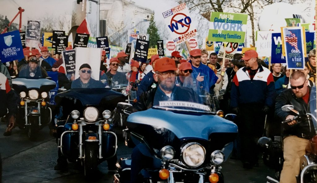 25,000 workers and trade unionists marched (and a few rode) through Seattle to protest against the WTO's 1999 globalisation agenda (© Paul Coleman, London Intelligence).